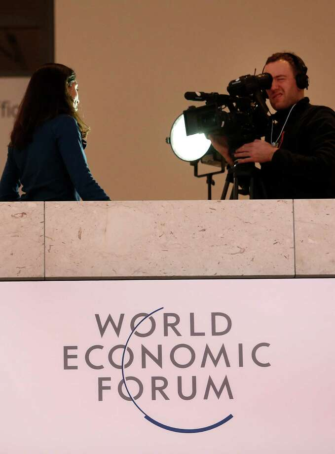 A television crew reports from inside the Congress Center on the opening day of the World Economic Forum (WEF) in Davos, Switzerland, on Wednesday, Jan. 23, 2013. World leaders, Influential executives, bankers and policy makers attend the 43rd annual meeting of the World Economic Forum in Davos, the five day event runs from Jan. 23-27. Photographer: Chris Ratcliffe/Bloomberg Photo: Chris Ratcliffe, Bloomberg / Copyright 2013 Bloomberg Finance LP, All Rights Reserved.
