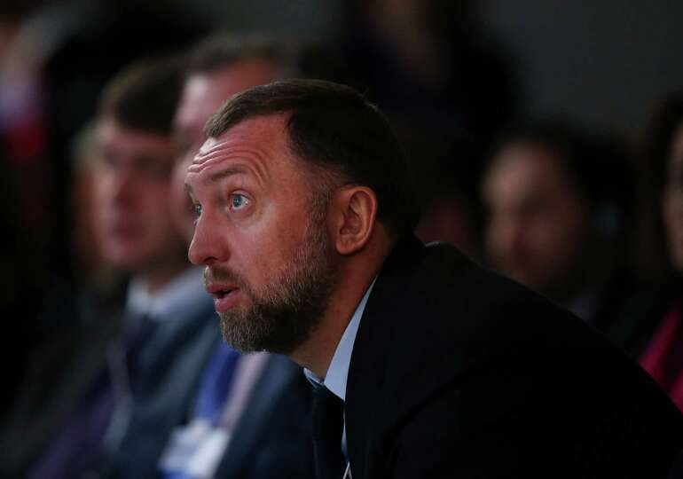 Oleg Deripaska, chief executive officer of United Co. Rusal, listens during the opening session on t