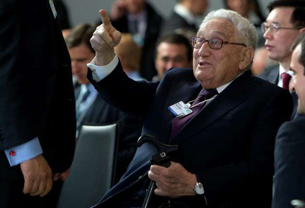 Former US secretary of state Henry Kissinger follows a session of the World Economic Forum Annual Meeting 2013 on January 23, 2013 at the Swiss resort of Davos. The World Economic Forum (WEF) will take place from January 23 to 27. AFP PHOTO / JOHANNES EISELEJOHANNES EISELE/AFP/Getty Images Photo: JOHANNES EISELE, AFP/Getty Images / AFP