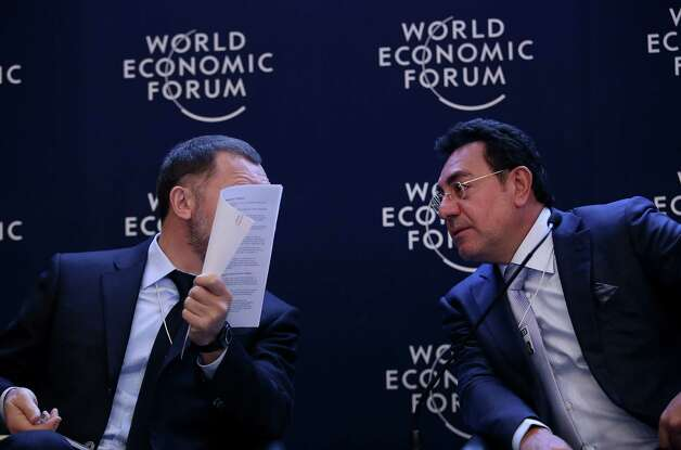 Oleg Deripaska, chief executive officer of United Co. Rusal, left, speaks with Samir Brikho, chief executive officer of Amec Plc, during a forum session on the opening day of the World Economic Forum (WEF) in Davos, Switzerland, on Wednesday, Jan. 23, 2013. World leaders, Influential executives, bankers and policy makers attend the 43rd annual meeting of the World Economic Forum in Davos, the five day event runs from Jan. 23-27. Photographer: Chris Ratcliffe/Bloomberg *** Local Caption *** Oleg Deripaska; Samir Brikho Photo: Chris Ratcliffe, Bloomberg / Copyright 2013 Bloomberg Finance LP, All Rights Reserved.