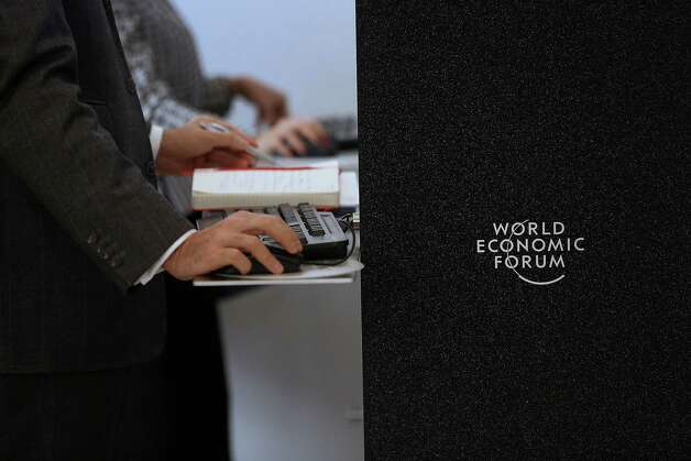 An attendee uses a computer on the opening day of the World Economic Forum (WEF) in Davos, Switzerland, on Wednesday, Jan. 23, 2013. World leaders, Influential executives, bankers and policy makers attend the 43rd annual meeting of the World Economic Forum in Davos, the five day event runs from Jan. 23-27. Photographer: Chris Ratcliffe/Bloomberg Photo: Chris Ratcliffe, Bloomberg / Copyright 2013 Bloomberg Finance LP, All Rights Reserved.