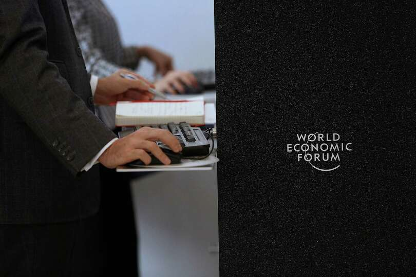 An attendee uses a computer on the opening day of the World Economic Forum (WEF) in Davos, Switzerla