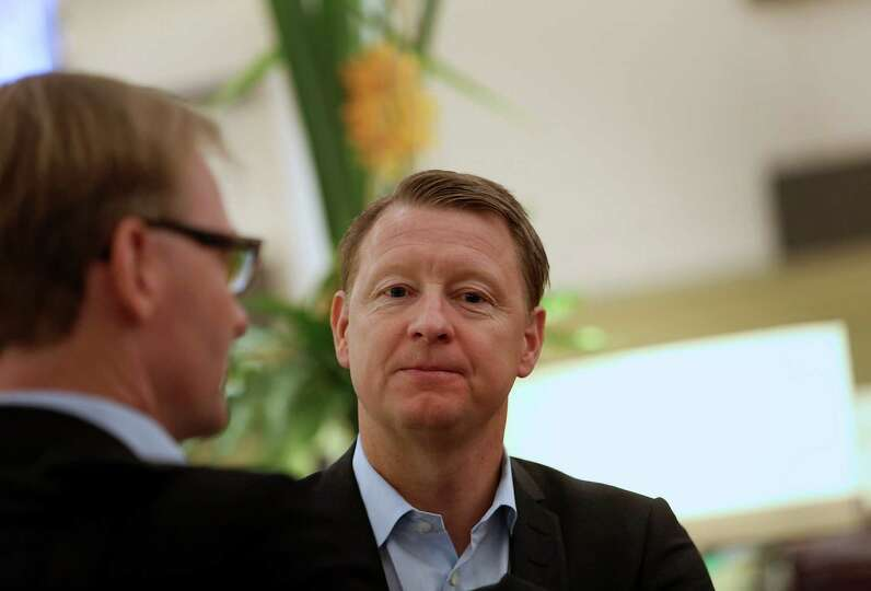 Hans Vestberg, chief executive officer of Ericsson AB, speaks with an attendee in the halls on the o
