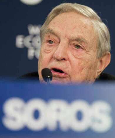 George Soros, chairman of Soros Fund Management, speaks during a press conference on the first day of the 43rd Annual Meeting of the World Economic Forum, WEF, in Davos, Switzerland, Wednesday, Jan. 23, 2013. ( AP Photo/Keystone/Jean-Christophe Bott) Photo: Jean-christophe Bott, Associated Press / KEYSTONE