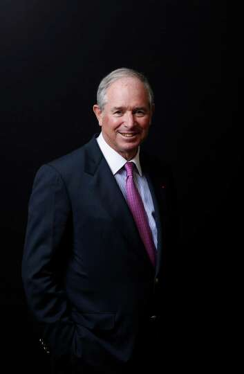 Stephen Schwarzman, chairman and chief executive officer of Blackstone Group LP, poses for a photogr