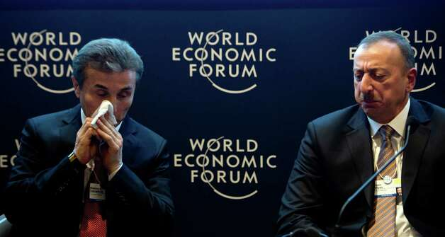President of Azerbaijan Ilham Aliyev (R) talks with the Prime Minister of Georgia Bizdina G. Ivanishvili during a discussion panel at the World Economic Forum 2013 annual meeting in the Swiss resort town of Davos, on January 23, 2013. The World Economic Forum (WEF) is taking place from January 23 to 27. AFP PHOTO / JOHANNES EISELEJOHANNES EISELE/AFP/Getty Images Photo: JOHANNES EISELE, AFP/Getty Images / AFP