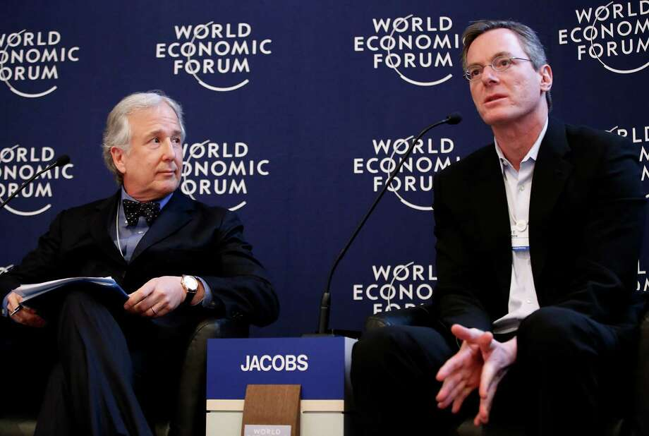 Paul Jacobs, chairman and chief executive officer of Qualcomm Inc., right, speaks while Matthew Winkler, editor-in-chief at Bloomberg News, listens during a forum session on the opening day of the World Economic Forum (WEF) in Davos, Switzerland, on Wednesday, Jan. 23, 2013. World leaders, Influential executives, bankers and policy makers attend the 43rd annual meeting of the World Economic Forum in Davos, the five day event runs from Jan. 23-27. Photographer: Jason Alden/Bloomberg *** Local Caption *** Paul Jacobs; Matthew Winkler Photo: Jason Alden, Bloomberg / Copyright 2013 Bloomberg Finance LP, All Rights Reserved.