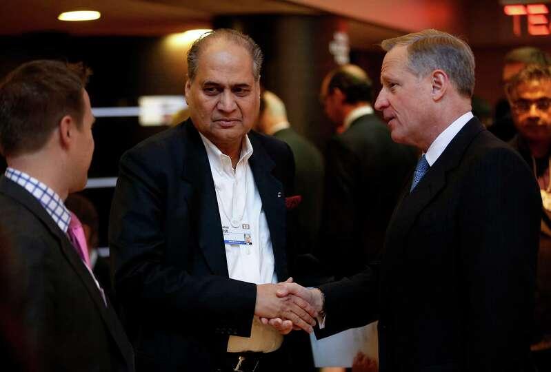 Rahul Bajaj, Indian billionaire and chairman of Bajaj Auto Ltd., left, greets Henry Ross Perot Jr.,