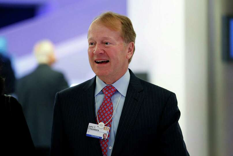 John Chambers, chief executive officer of Cisco Systems Inc., arrives on the opening day of the Worl