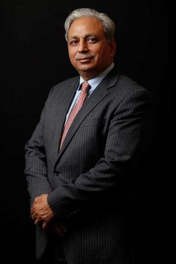 Anand Mahindra, chairman of Mahindra & Mahindra Ltd., poses for a photograph following a Bloomberg T