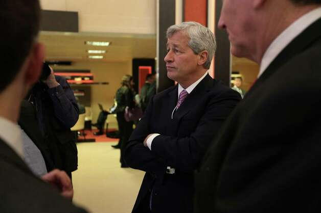 "James ""Jamie"" Dimon, chief executive officer of JPMorgan Chase & Co., speaks to an attendee before a forum session on the opening day of the World Economic Forum (WEF) in Davos, Switzerland, on Wednesday, Jan. 23, 2013. World leaders, Influential executives, bankers and policy makers attend the 43rd annual meeting of the World Economic Forum in Davos, the five day event runs from Jan. 23-27. Photographer: Jason Alden/Bloomberg *** Local Caption ***  Jamie Dimon Photo: Jason Alden, Bloomberg / Copyright 2013 Bloomberg Finance LP, All Rights Reserved."