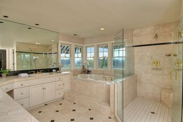 The master bathroom has a spa tub and step-in shower with sitting area. Photo: Matt McCourtney, McCourtney Photographics