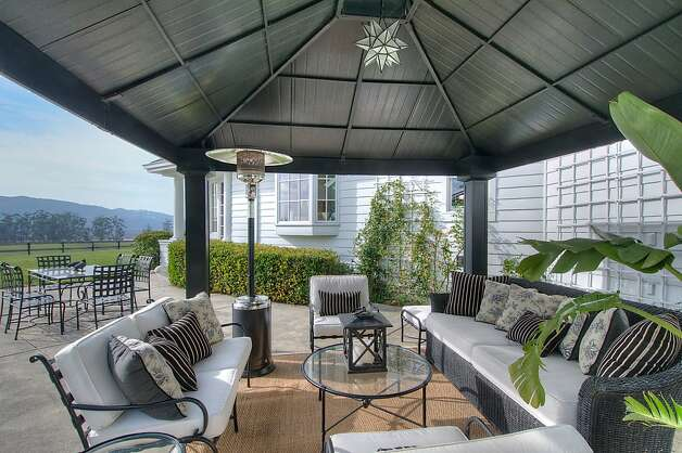 A covered lounge area provides a gathering place outdoors. Photo: Matt McCourtney, McCourtney Photographics