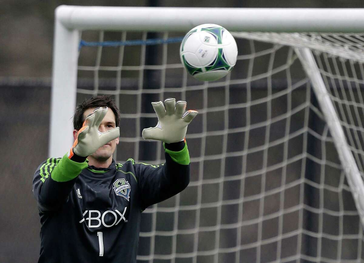 Seattle Sounders goalkeeper Michael Gspurning makes a stop during the Sounders' MLS soccer training camp in Tukwila, Wash., Tuesday, Jan. 22, 2013.