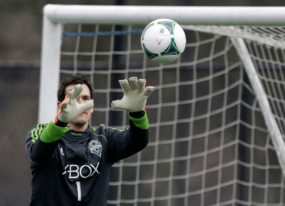 Seattle Sounders goalkeeper Michael Gspurning makes a stop during the Sounders' MLS soccer training camp in Tukwila, Wash., Tuesday, Jan. 22, 2013. Photo: Ted S. Warren, Associated Press / Associated Press