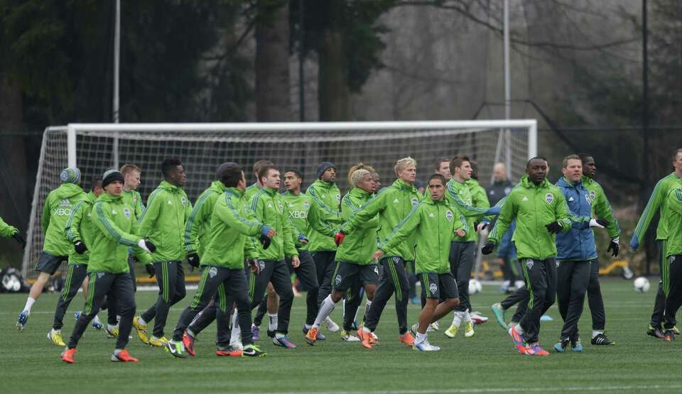 Seattle Sounders players run during a MLS soccer training camp in Tukwila, Wash., Tuesday, Jan. 22,
