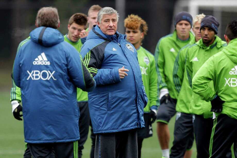 Seattle Sounders head coach Sigi Schmid, second from left, talks to his team during MLS soccer training camp in Tukwila, Wash., Tuesday, Jan. 22, 2013.  Photo: Ted S. Warren, Associated Press / Associated Press