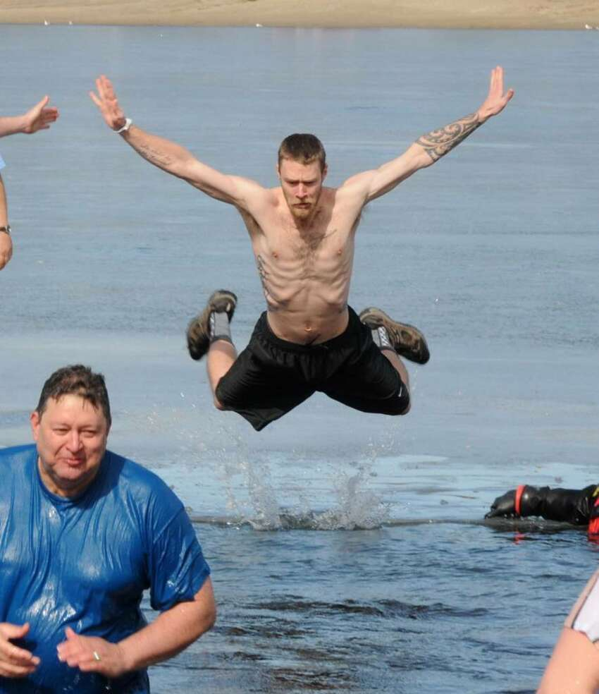 Jack Knapp Sr. Danbury Dip for Charity. Members of the Moose Lodge jump into chilly Lake Kenosia on Saturday to raise money for charity. L, Jack Knapp Jr. (the founders son) wades out of the water and R, John Webber III takes the dive. February 2009