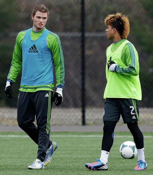 Seattle Sounders' Eriq Zavaleta, left, stands with DeAndre Yedlin, right, during an MLS soccer train