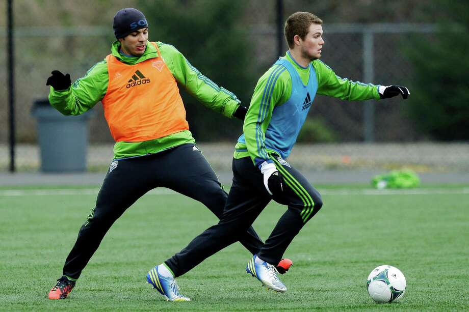 Seattle Sounders' Eriq Zavaleta, right, moves the ball past Sammy Ochoa, left, during an MLS soccer training camp scrimmage in Tukwila, Wash., Tuesday, Jan. 22, 2013. Photo: Ted S. Warren, Associated Press / Associated Press