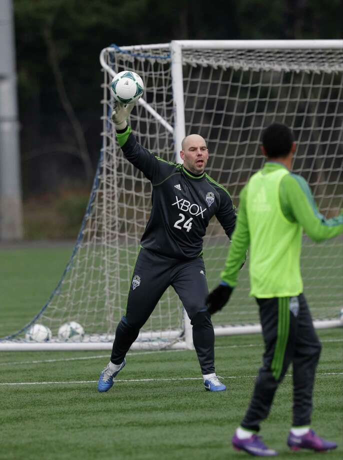 Seattle Sounders goalkeeper Marcus Hahnemann (24) returns the ball during the Sounders' MLS soccer training camp in Tukwila, Wash., Tuesday, Jan. 22, 2013. Photo: Ted S. Warren, Associated Press / Associated Press