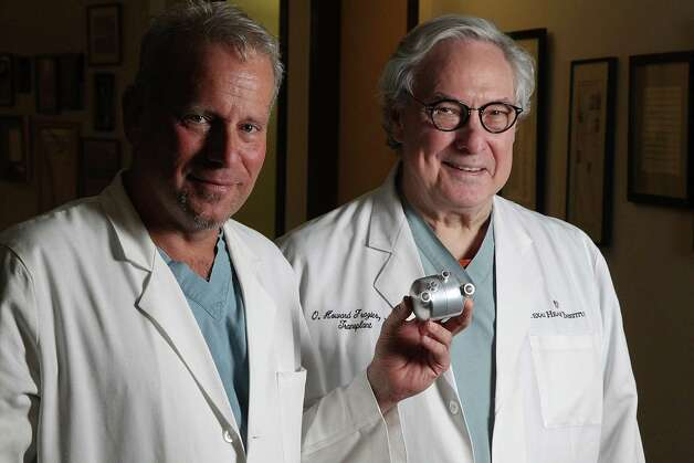 "Dr. William Cohn, M.D. and Dr. O.H. ""Bud"" Frazier M.D. are photographed with the BiVACOR at the Texas Heart Institute in St. Luke's Hospital on Wednesday, Jan. 9,  2013, in Houston. Jim McIngvale is donating $2.1 million to the Texas Heart Institute to bring the Australian engineer and his staff to further develop his revolutionary artificial heart, BiVACOR, to Houston. ( Mayra Beltran / Houston Chronicle ) Photo: Mayra Beltran, Staff / © 2013 Houston Chronicle"