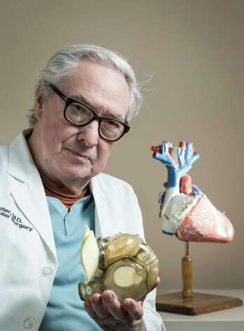 "O.H. ""Bud"" Frazier, M.D. is chief of Cardiopulmonary Transplantation, program director and chief of the Center for Cardiac Support, and director of Cardiovascular Surgery Research at the Texas Heart Institute, poses for a portrait with a total artificial heart at the Texas Heart Institute, Thursday, Jan. 17, 2013, in Houston.  Frazier is a pioneer in the surgical treatment of severe heart failure, specifically in the fields of heart transplantation and mechanical circulatory support to be used either to substitute for or to assist the pumping action of the human heart.  ( Michael Paulsen / Houston Chronicle ) Photo: Michael Paulsen, Staff / © 2013 Houston Chronicle"