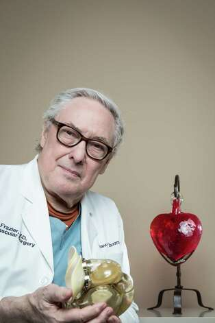 "Dr. O.H. ""Bud"" Frazier, holding a total artificial heart at the Texas Heart Institute, was inspired to work on heart-pump technology while he was a medical student working with cardiologist Dr. Michael DeBakey. Photo: Michael Paulsen, Staff / © 2013 Houston Chronicle"