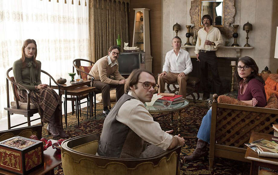 Here's Rory Cochrane in Argo, playing one of the six U.S. Embassy workers who escaped the takeover in Tehran. Don't recognize him? He's the bowl-cut guy standing in the back, rocking an awesome mustache.