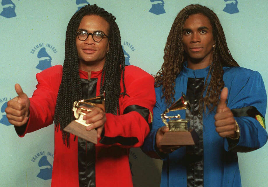 "Famous pop dou Rob Pilatus and Fabrice Morvan once known as the sensation ""Milli Vanilli,"" are now known as the most scandalous lip-synching act in all of music history. Why? Well, not only were they caught lip-synching throughout ""live"" performances, but their one and only album titled ""All or Nothing"" was completely phony too.  Their voices were not used for one track in the entire album. When the truth was finally revealed in 1990, they became the first act to be stripped of a Grammy award. (Allmusic.com, Ranker.com) Photo: DOUGLAS C. PIZAC, AP"