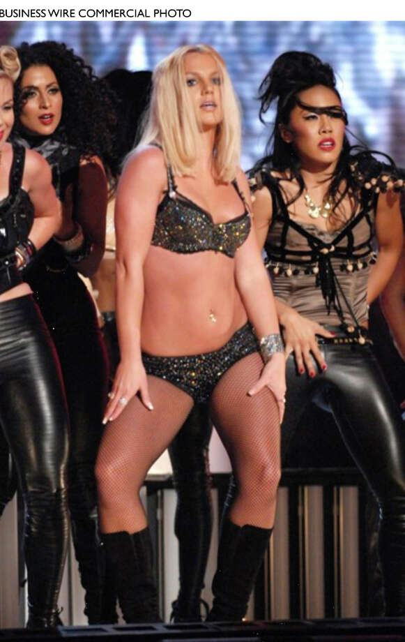 "Britney Spear's career has been a roller coaster ride from the very beginning, which is why it was no surprise that she was caught lip-syncing at the 2007 Video Music Awards.  Wearing a sparkly black bikini top and bottom, the singer stumbled to lip-sync through her hit song ""Gimme More,"" at MTV's award show.  Fellow artists who sat just feet away from the stage were shown rolling their eyes and even laughing at the star's poor performance.  (Nydailynews.com) Photo: BUSINESS WIRE / eBay Inc."
