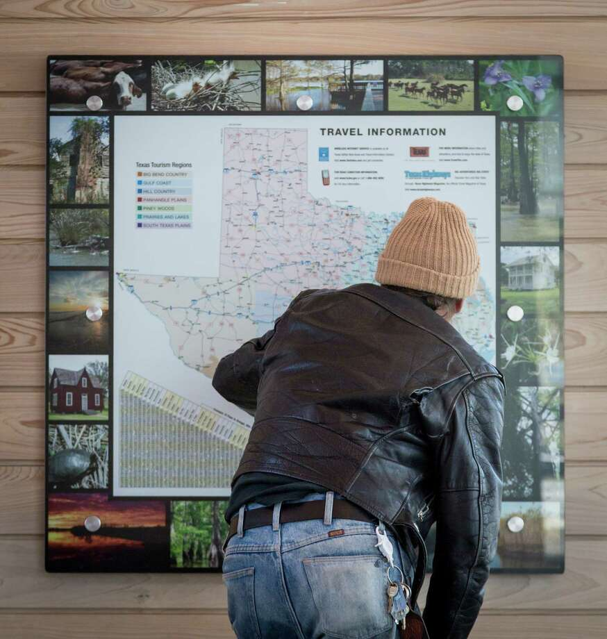 John Contois looks at a map at the Chambers County Safety Rest Area. Photo: Michael Paulsen, Houston Chronicle / © 2013 Houston Chronicle