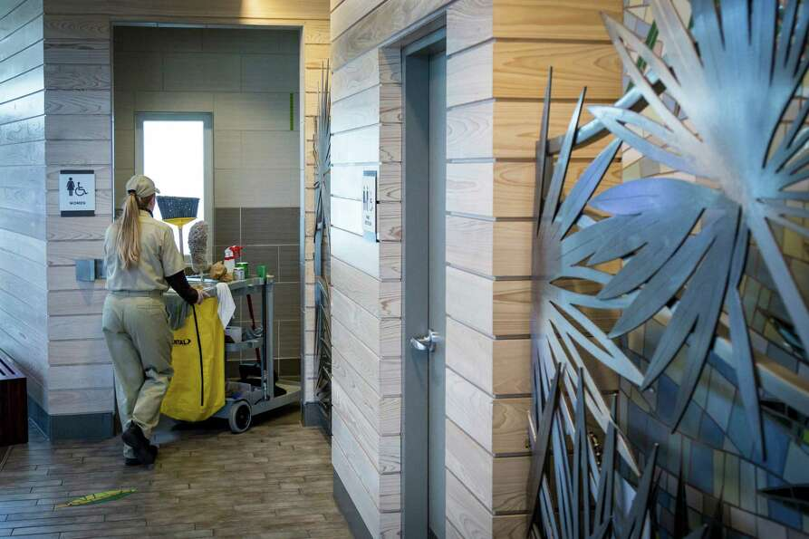 Cheryl McDaniel cleans a restroom at the Chambers County Safety Rest Area.