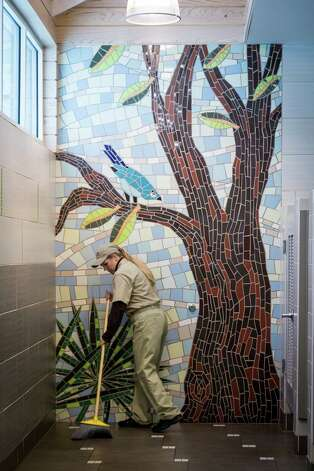 Cheryl McDaniel cleans a restroom at the Chambers County Safety Rest Area, 1-hour east of Houston, Thursday, Jan. 17, 2013, near Hankamer. Photo: Michael Paulsen, Houston Chronicle / © 2013 Houston Chronicle