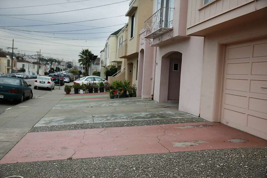 Paved areas in front of homes, such as these on 30th Avenue, raise concerns over drainage and curb appeal. Photo: Lea Suzuki, The Chronicle
