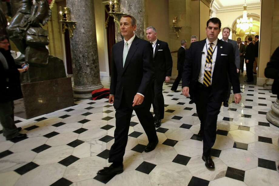 House Speaker John Boehner of Ohio leaves a news conference on Capitol Hill in Washington, Wednesday, Jan. 23, 2013 where he discussed the debt limit. The House overwhelmingly passed a bill Wednesday to permit the government to borrow enough money to avoid a first-time default for at least four months, defusing a looming crisis and setting the stage for a springtime debate over taxes, spending and the deficit. (AP Photo/Jacquelyn Martin) Photo: Jacquelyn Martin, Associated Press / AP
