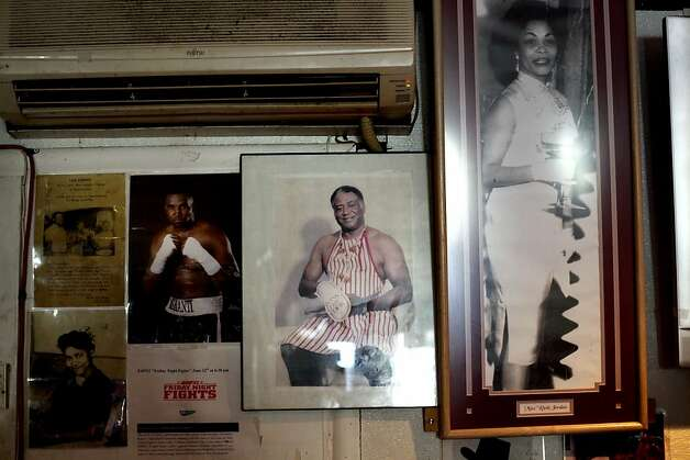 Sam Jordan's photo, center, is featured along with other family members on the wall of Sam Jordan's Bar in San Francisco, Calif., Monday, January 21, 2013.  The bar recently obtained landmark status. Photo: Sarah Rice, Special To The Chronicle