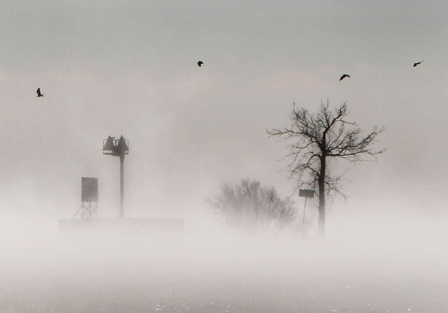Fog gathers over  Lake Winnebago during a stretch of  bitter cold weather Tuesday Jan. 22, 2013, in Menasha, Wis.  The upper Midwest is in a third straight day of bitter cold temperatures.  (AP Photo/The Post-Crescent, William Glasheen ) NO SALES Wm. Glasheen/The Post-Crescent Photo: William Glasheen, ASSOCIATED PRESS / Wm. Glasheen/The Post-Crescent2013