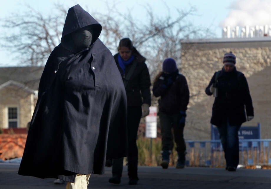 Lawrence University student Joshua Hebda is bundled against the cold as he walks on campus  January 22, 2013, in Appleton, Wis.  The upper Midwest is in it's a third straight day of bitter cold temperatures.  (AP Photo/The Post-Crescent,William Glasheen) NO SALES Photo: William Glasheen, ASSOCIATED PRESS / Wm. Glasheen/The Post-Crescent2013