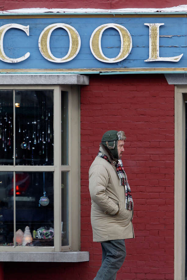 A man walks by a shop on Main St. in freezing temperatures on Wednesday, Jan. 23, 2013 in Montpelier, Vt. Sub-zero low temperatures are forecast for the area.  (AP Photo/Toby Talbot) Photo: Toby Talbot, ASSOCIATED PRESS / AP2013