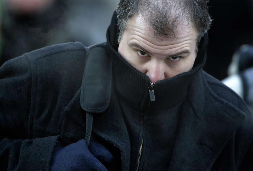 A Commuter bundles up against extreme cold conditions Tuesday, Jan. 22, 2013, in Chicago. Temperatur