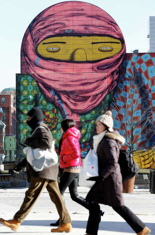 People walk past a mural painted on the side of a building in Boston, Wednesday, Jan. 23, 2013.  The National Weather Service says it's not expected to get above 17 degrees in Boston, with the wind chill making it feel five below.  (AP Photo/Michael Dwyer) Photo: Michael Dwyer, ASSOCIATED PRESS / AP2013