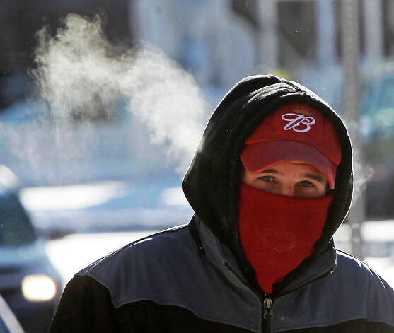 Steam rises from a pedestrian on Wednesday, Jan. 23, 2013 in Barre, Vt.  The National Weather Service said states from Ohio through to the far northeast of Maine could expect to be slammed by an Arctic blast on Wednesday.(AP Photo/Toby Talbot) Photo: Toby Talbot, ASSOCIATED PRESS / AP2013