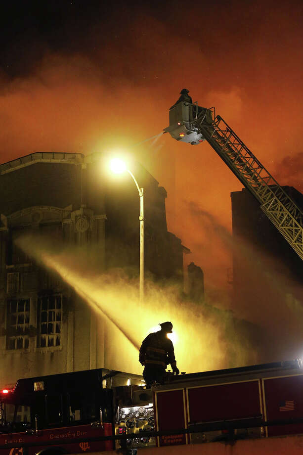 Chicago firefighters battle a five-alarm blaze in single digit temperatures at a warehouse on the city's South Side, Bridgeport neighborhood Wednesday, Jan. 23, 2013, in Chicago. (AP Photo/Charles Rex Arbogast) Photo: Charles Rex Arbogast, ASSOCIATED PRESS / AP2013
