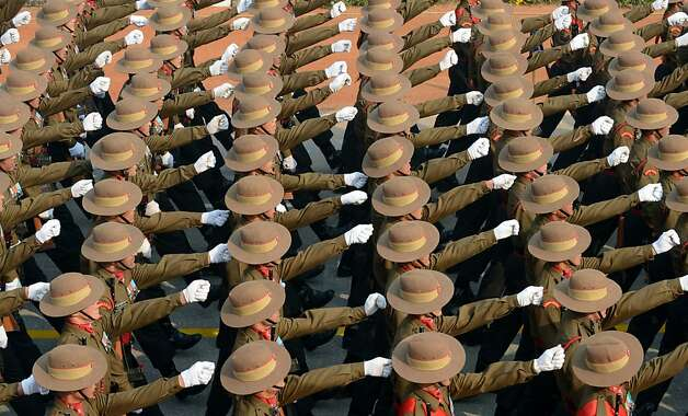 Draw invisible swords, ho! Indian soldiers march in formation at Rajpath during a full dress rehearsal for the Indian Republic Day parade in New Delhi. Photo: Raveendran, AFP/Getty Images