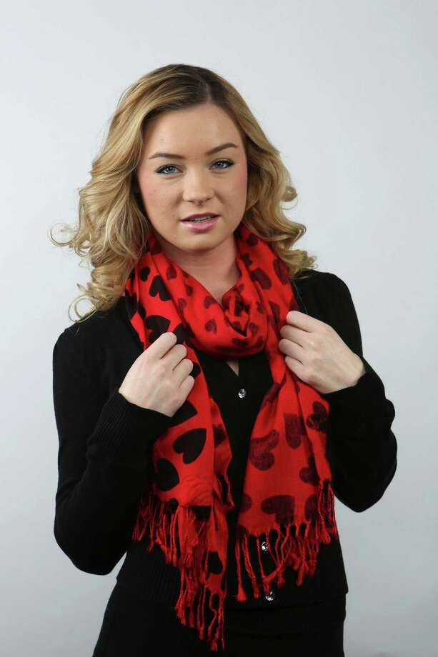 You've heard of wearing your heart on your sleeve, how about around your neck? A model wears this cozy heart-motif scarf, $28, from On Main/Off Main. Photo: Helen L. Montoya, San Antonio Express-News / ©2013 San Antonio Express-News