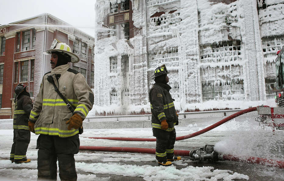 CHICAGO, IL - JANUARY 23: Firefighters work to extinguish a massive blaze at a vacant warehouse on J