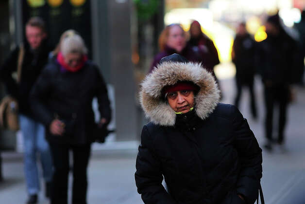 NEW YORK, NY - JANUARY 22:  A woman walks down the street on one of the coldest days of the year on January 22, 2013 in New York City. New York, and much of the Northeast, will be experiencing colder-than-usual temperatures for the remainder of the week with temperatures in the 20's and a wind chill feeling in the single digits. Photo: Spencer Platt, Getty Images / 2013 Getty Images