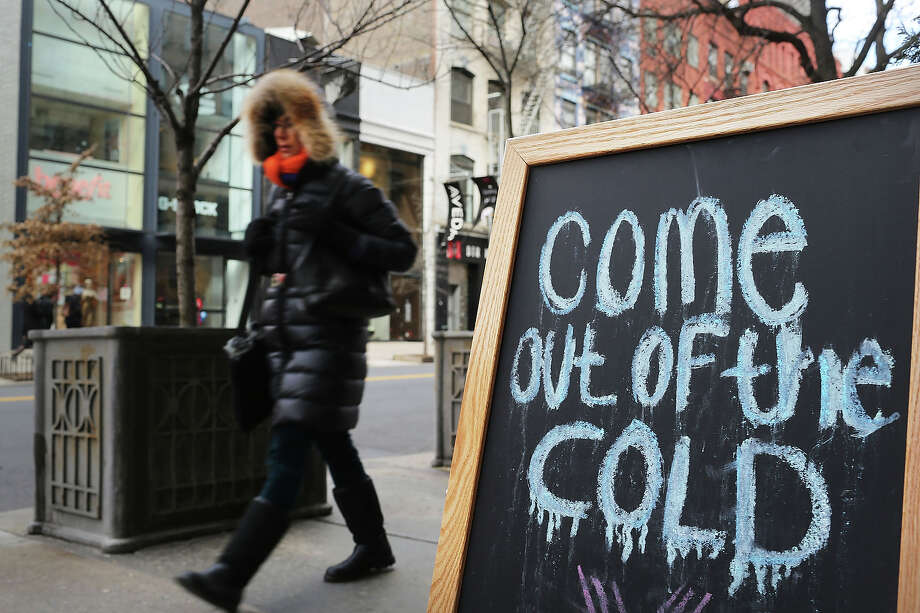 NEW YORK, NY - JANUARY 23: A woman walks down a street on one of the coldest days of the year on January 23, 2013 in New York City. Much of the Northeast, will be experiencing colder than usual temperatures for the remainder of the week with temperatures in the 20's and a wind chill feeling in the single digits. Photo: Spencer Platt, Getty Images / 2013 Getty Images