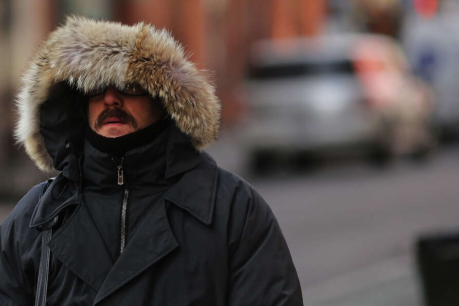 NEW YORK, NY - JANUARY 23: A man walks down a street on one of the coldest days of the year on Janua